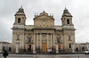 The Metropolitan Cathedral, Guatemala City's main church, is located in the main square of the city. Notice the pillars in front of the church.