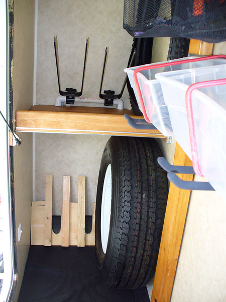 front wheel secure points and rear wheel supports next to spare tire