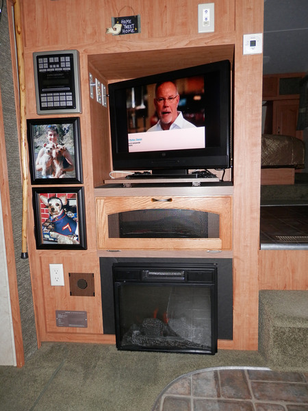 Note picture frame cabinet doors and vented cabinet door all closed around TV. Photos can be changed as desired.