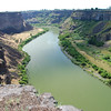 "The Snake River gorge at Twin Falls, Idaho.  The ""twin falls"" are made by two smaller rivers that plunge into the canyon here."
