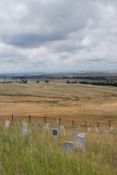 "After spending my birthday night in the Wal-Mart parking lot in Sheridan, Wyoming, we continued into Montana to visit the Battlefield of Little Bighorn, also known as Custer's Last Stand.  Custer's grave is the one in black.  Montana's ""Big Sky"" was evident in the scenery here."