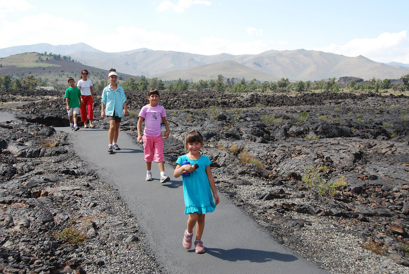 "Along the way we stopped at Craters of the Moon National Monument.  This is an area of volcanic activity created by the same ""hot spot"" that now fuels Yellowstone's geysers.  Here we are walking through a lava field."