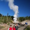 """Our last day in Yellowstone was """"geothermal day""""!  Here's a hot spring (or is it a geyser?  or a fumarole?) continuously spewing sulpher smoke into the air."""