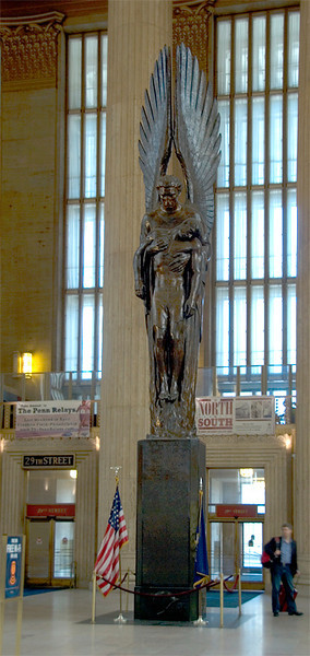 Amtrak's 30th Street Station, Philadelphia, Pennsylvania Railroad World War II Memorial, a bronze statue which honors Pennsylvania Railroad employees killed in World War II. It consists of a statue of the archangel Michael lifting the body of a dead soldier out of the flames of war, sculpted by Walker Hancock in 1950. On the four sides of the base are the 1,307 names of the Pennsylvania Railroad employees who died in World War II.