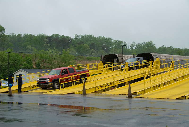 Amtrak's Auto Train vehicles are unloading and going down the ramps at the Lorton Virginia station