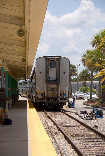 Amtrak's Auto Train detail of the end of a lounge car getting last minute maintenance at Sanford Florida station