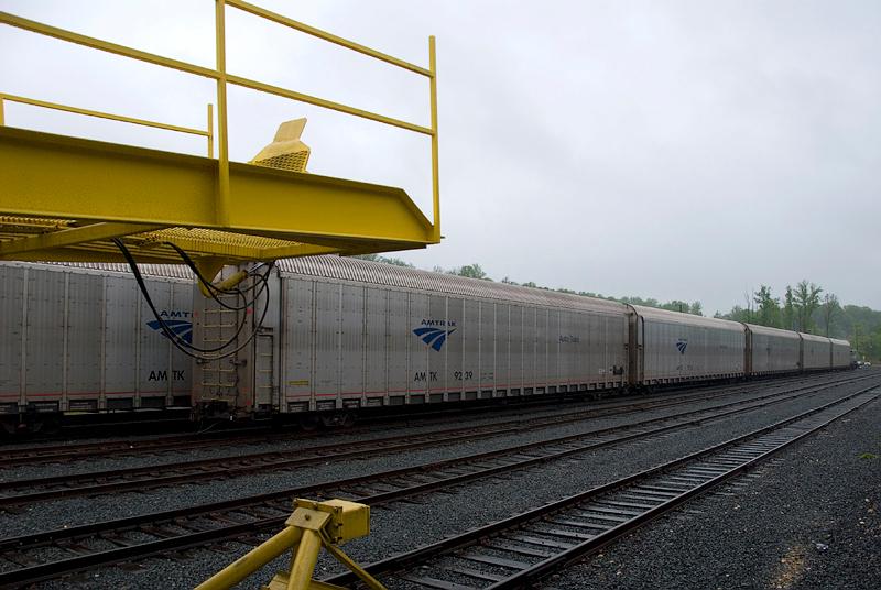 Amtrak's Auto Train unloading vehicles at Lorton Virginia station in full swing