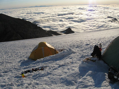Base camp above the clouds and smaller mountains at dawn (we were close to the top around that time)