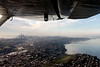 Small plane wing over Seattle Washington