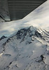 Small plane wing over Mount Rainier Seattle Washington