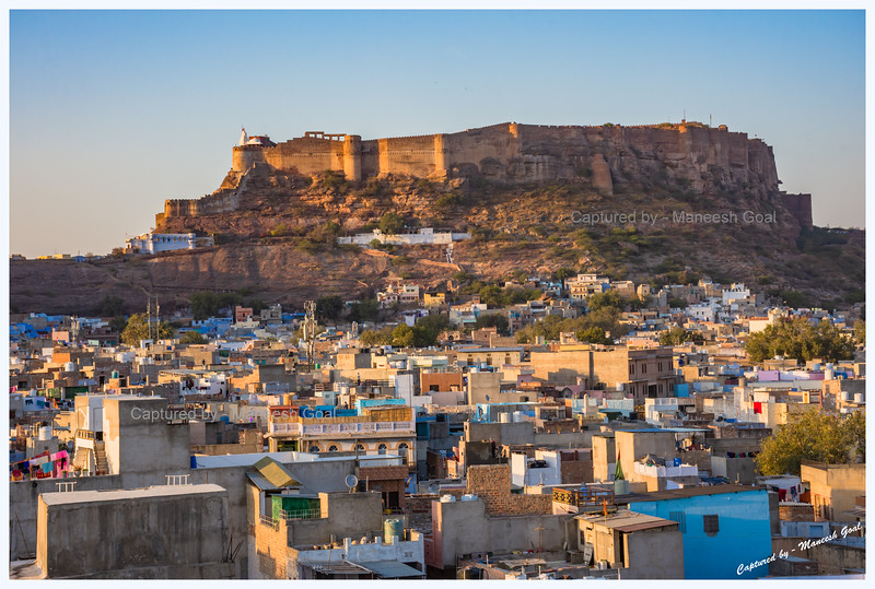 Blue city, Jodhpur, bathed in the golden light of evening. Mehrangarh Fort in the background.