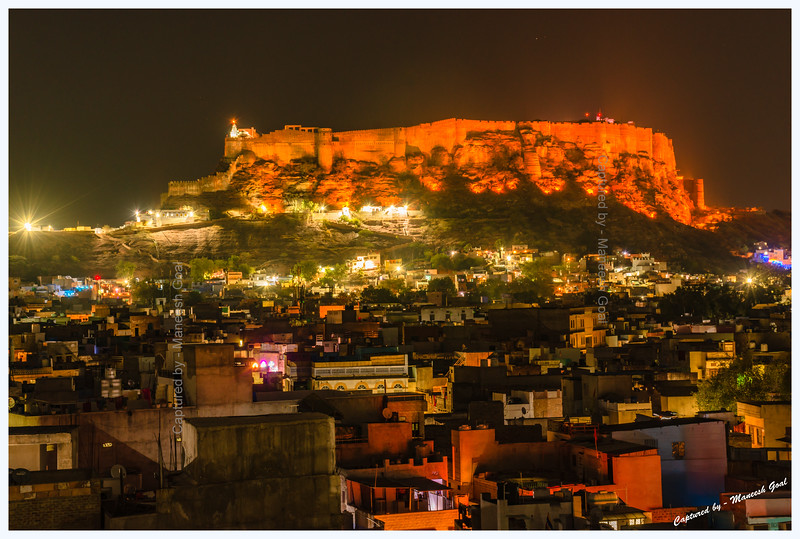 Blue city at night. Jodhpur. Mehrangarh Fort in the background.