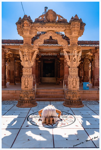 Devotee bowing before the deity at Osian Jain Temple near Jodhpur