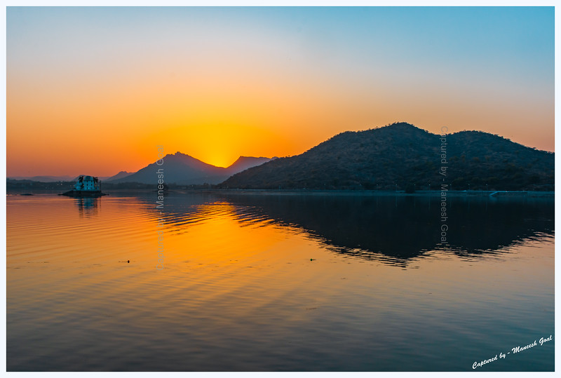 Colours of sunset over Fateh Sagar Lake, Udaipur. Solar Observatory, located on an island, can be seen in the middle-left of the picture.