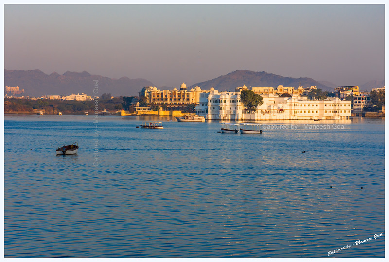 Lake Palace, located on an island in Lake Pichola, bathed in the golden light of sunrise. Udaipur