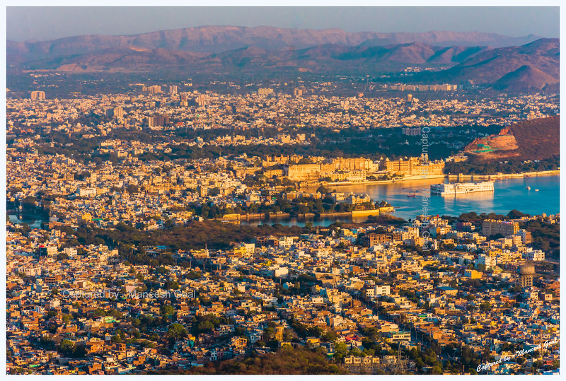 View of the city around Lake Pichola, washed in the golden light of sunset. City Palace (located on the banks of Lake Pichola) and Lake Palace (located on an island) can be seen in this picture taken from Sajjangarh Monsoon Palace, Udaipur.