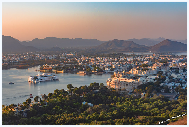 Udaipur City in the golden light of evening. Picture taken from Machla Magra hilltop near Dudh Talai