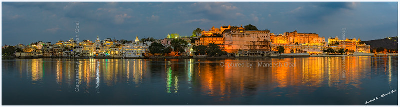 Panoramic view of City Palace and various ghats, located on the banks of Lake Pichola, at dusk. Picture taken from Ambrai Ghat, Udaipur.