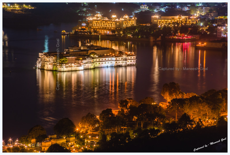 View of Lake Palace, Ambrai Ghat and Lake Pichola at night. Picture taken from Machla Magra hilltop near Dudh Talai, Udaipur.