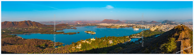 Panoramic view of Lake Pichola, Udaipur, in the golden morning light.