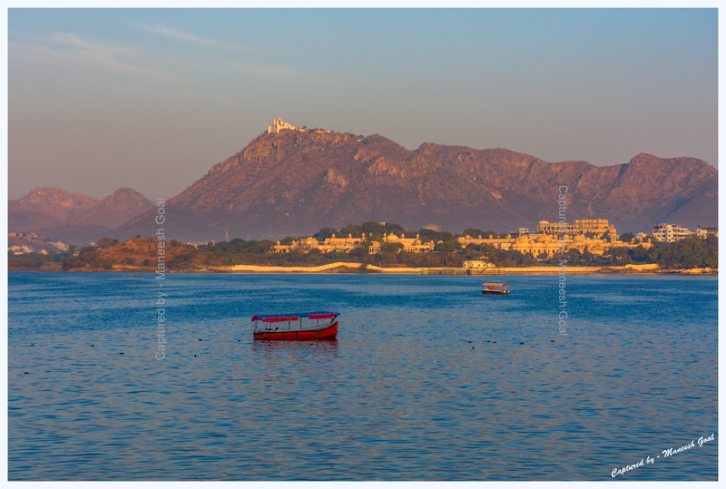 Hotel Oberoi Udaivilas, located on the banks of Lake Pichola, and Sajjangarh Monsoon Palace (hilltop) bathed in the golden light of sunrise. Udaipur