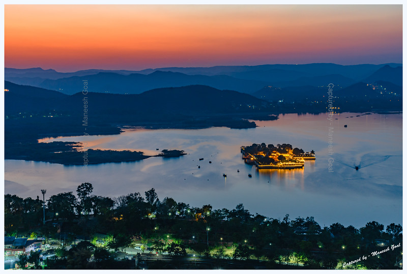 View of Jag Mandir Palace, located on an island in Lake Pichola, at dusk. Picture taken from Machla Magra hilltop near Dudh Talai.