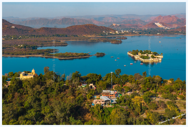 Jag Mandir Palace, located on an island in Lake Pichola, bathed in the golden morning light. Udaipur