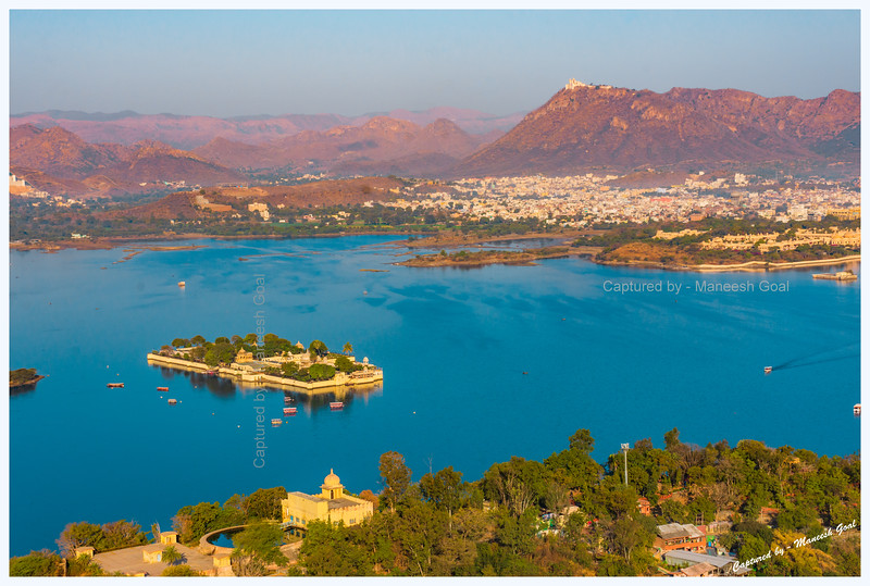 View of Jag Mandir Palace, located on an island in Lake Pichola, and Sajjangarh Monsoon Palace (hilltop) in the golden morning light. Udaipur