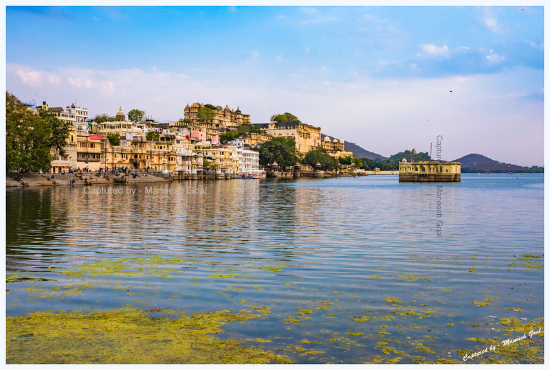 View of Gangaur Ghat and City Palace, located on the banks of Lake Pichola, from Chand Pol Bridge, Udaipur