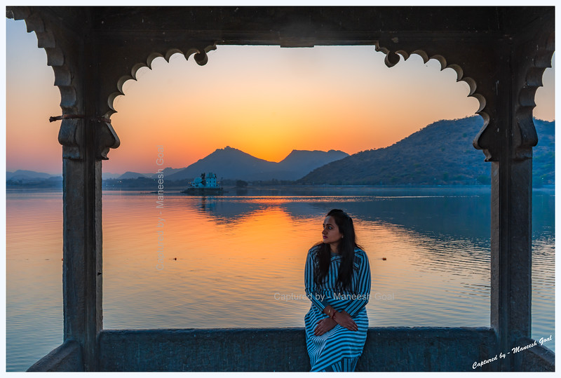 Wife relishing the colours of sunset over Fateh Sagar Lake, Udaipur