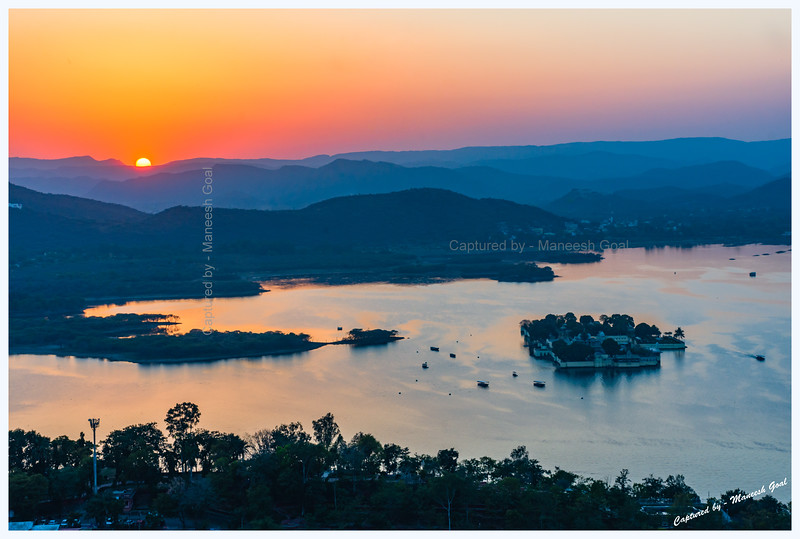 View of Jag Mandir Palace, located on an island in Lake Pichola, during sunset. Picture taken from Machla Magra hilltop near Dudh Talai.