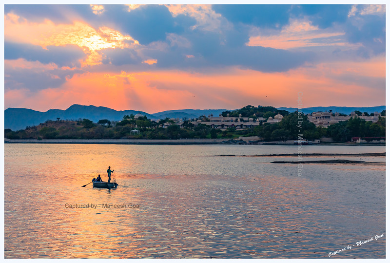 Fishermen in Lake Pichola. Oberoi Udaivilas Hotel in the background. Udaipur