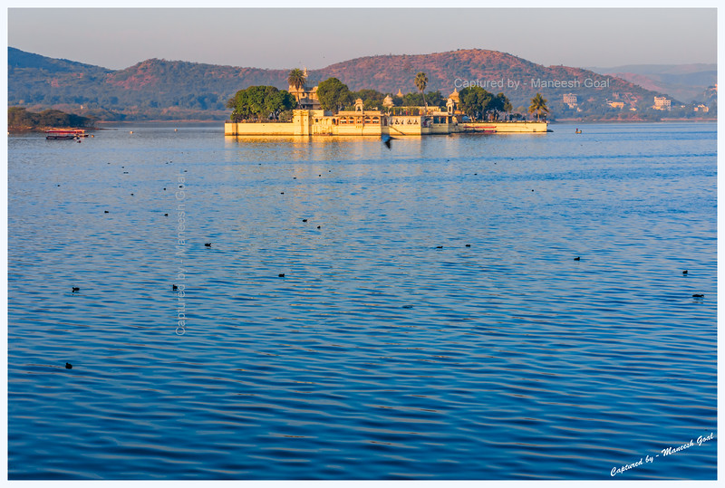 Jag Mandir Palace, located on an island in Lake Pichola, bathed in the golden light of sunrise. Udaipur