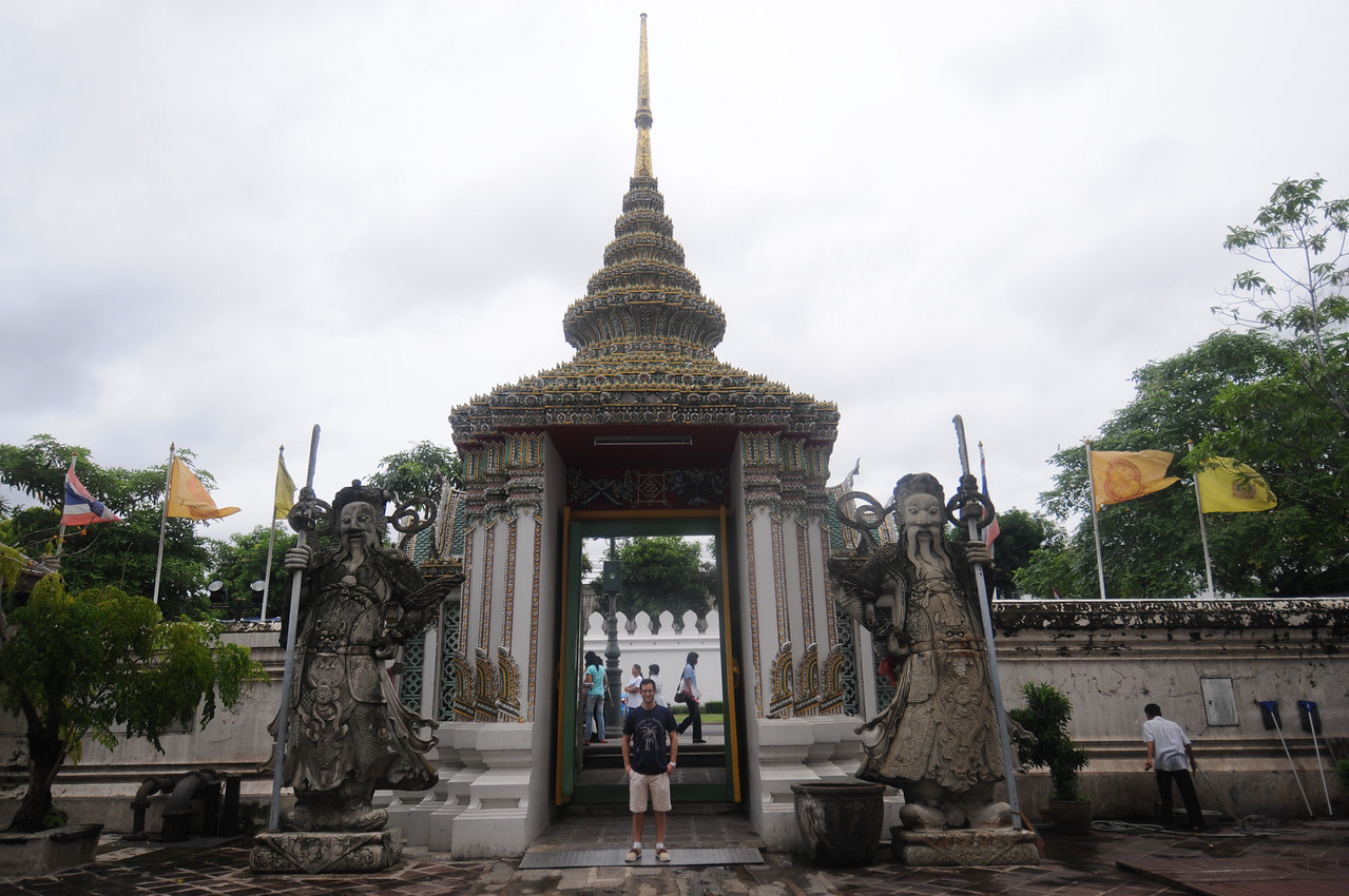 Dave in front of the gates to the complex where the giant reclining Buddha is.