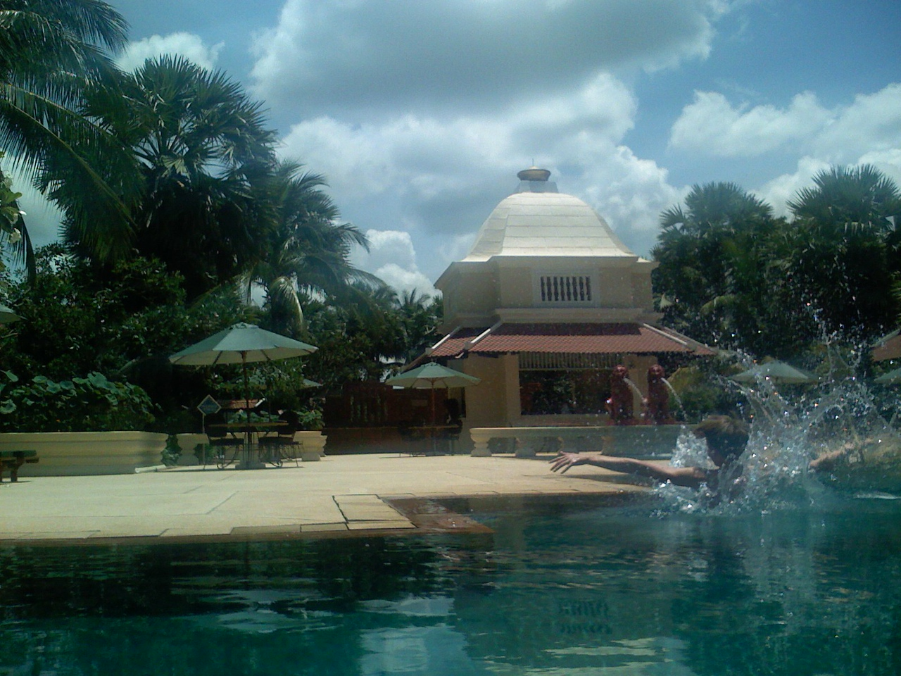 Kyle Kolb seen mid-splash after cartwheeling into the pool at the Raffles in Cambodia.  We dared him to do it.