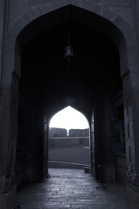A silhouette of the front gates of the Red Fort of Agra with a blue hue.