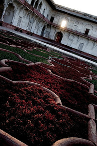 Sunlight beams through a window in the fort and grazes the gardens within. - Red Fort of Agra