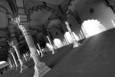 Exquisite arches at Diwan-I-Am within the Red Fort of Agra are pierced by the late afternoon sun - black and white.
