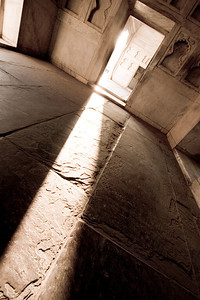The setting sun beams powerfully through the private rooms within the Red Fort of Agra.