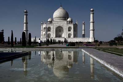 The Taj stands bold and the reflections grace one of the pools.  - Agra, India