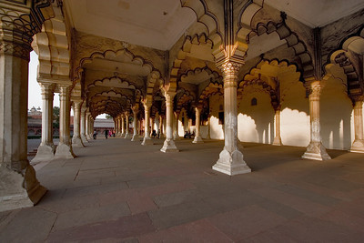 Exquisite arches at Diwan-I-Am within the Red Fort of Agra are pierced by the late afternoon sun.  This part of the fort is known at the Hall of Public Audience and was used to speak to people.  It also housed the Peacock Throne.