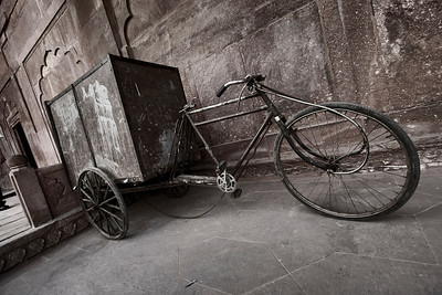 """A funky, modified """"cargo"""" bike sits against a wall just outside the Taj Mahal in Agra."""
