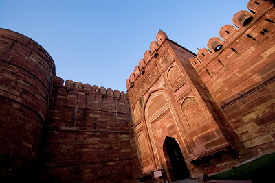 Late afternoon sun bounces off of the red sandstone at the Red Fort of Agra.