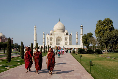A trio of monks make their way through the gardens that lead up to the Taj Mahal.  - Agra, India