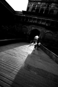 Sun shines through the front door of the Red Fort of Agra - black and white.