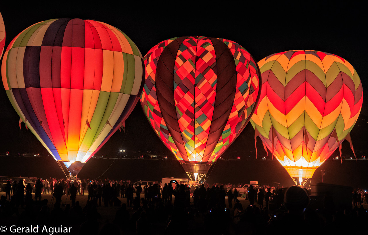 This is a close up view of three balloons before they took off that morning.