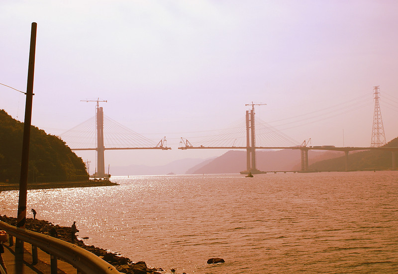 New suspension bridge being constructed over Masan Bay (Tacoma Narrows?)