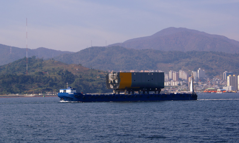A ship module being shipped out from Changwon on a towed barge - possibly to the STX Shipbuilding yard at Jimhae a few miles seaward down Masan Bay.