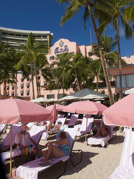 The pink umbrellas are, of course, reserved for guests of the Royal Hawaiian.