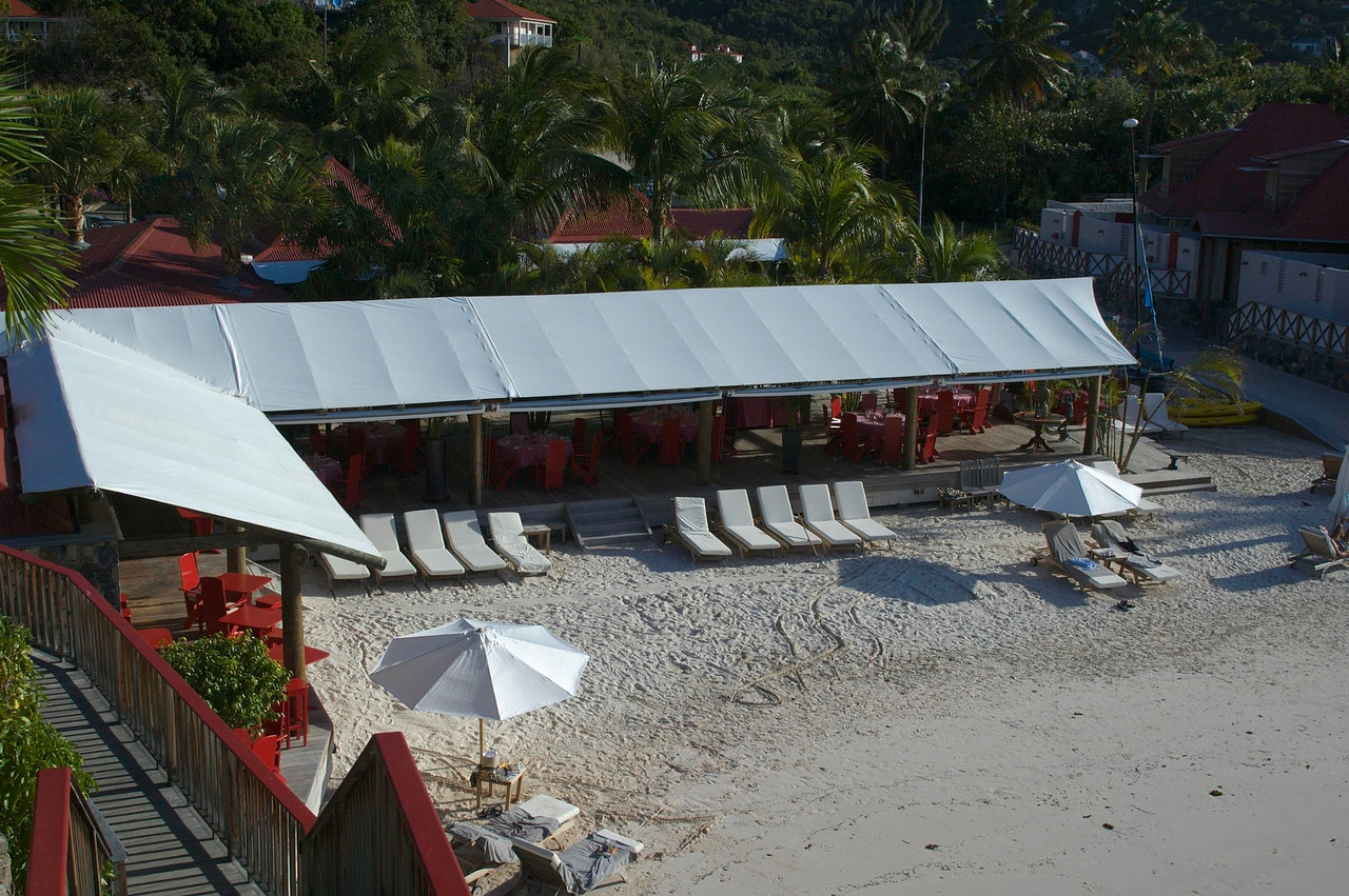 "The beachside restaurant ""Sand Bar"" as seen from the Eden Rock Hotel."